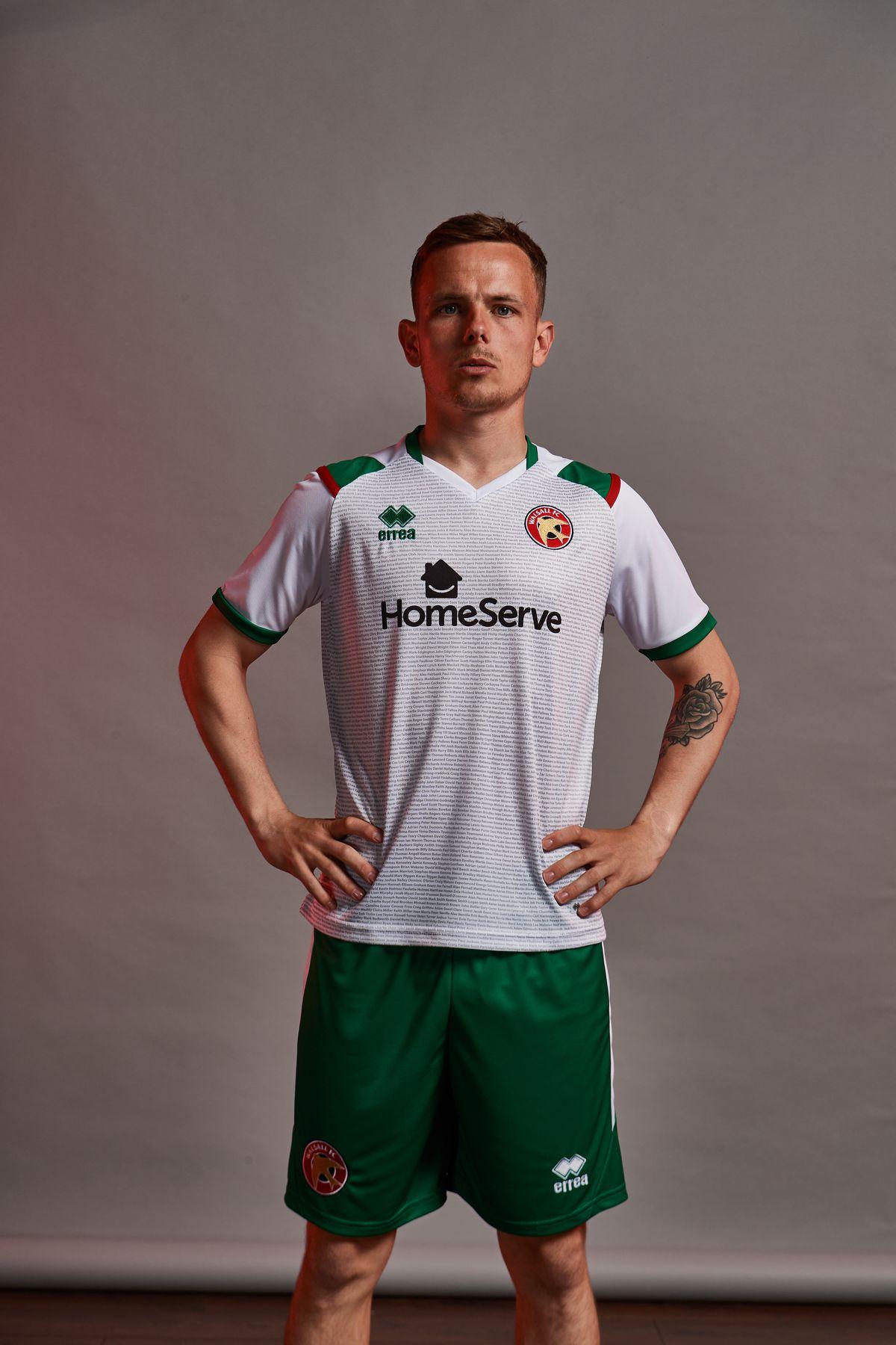 Liam Kinsella models the new third kit