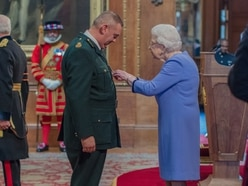 Ambulance boss receives top honour from The Queen