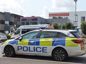 Police at the Emergency Department entrance of New Cross Hospital in Wolverhampton after a member of staff was stabbed
