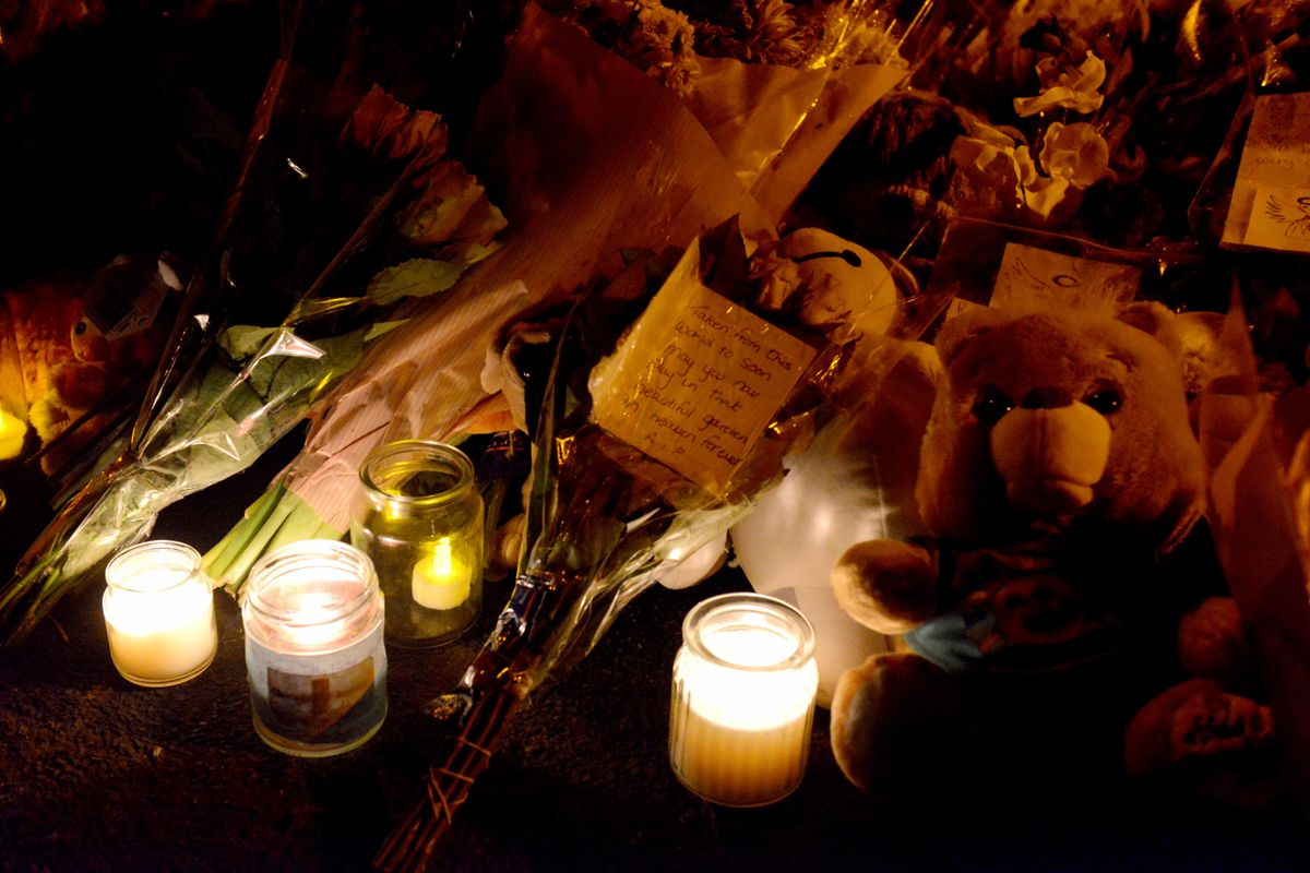 Candles and tributes left in memory of the children at last week's vigil