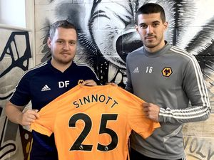 Conor Coady, right, poses with the shirt with Danny Fishwick