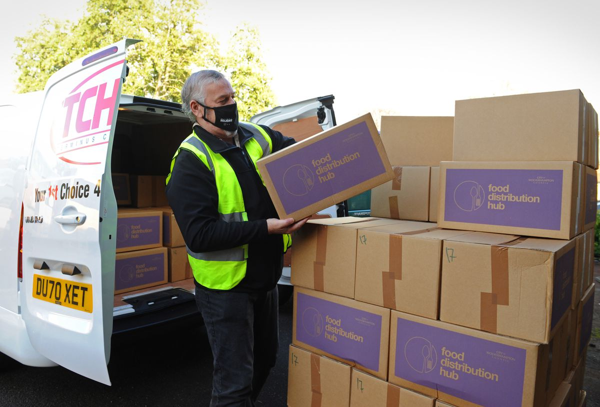 Ian Brookfield, leader of Wolverhampton Council, helps deliver food parcels