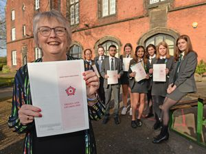 Award-winning pupils at Queen Mary's High School, Walsall, with headteacher Dr Alison Bruton