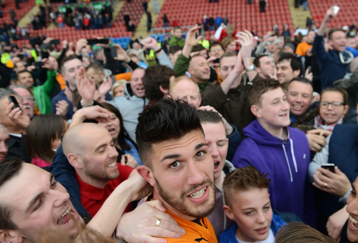 Batth was mobbed on the field after Wolves won promotion from League One away at Crewe (© AMA SPORTS PHOTO AGENCY)