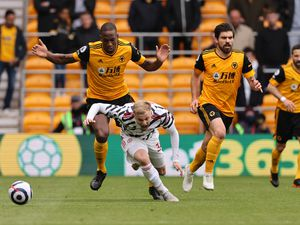 Willy Boly of Wolverhampton Wanderers and Donny van de Beek of Manchester United.