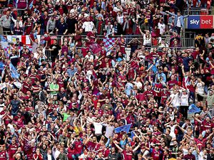Aston Villa fans in the stands celebrate as Aston Villa's Anwar El Ghazi (not in frame) scores their side's first goal of the game during the Sky Bet Championship Play-off final at Wembley Stadium, London.