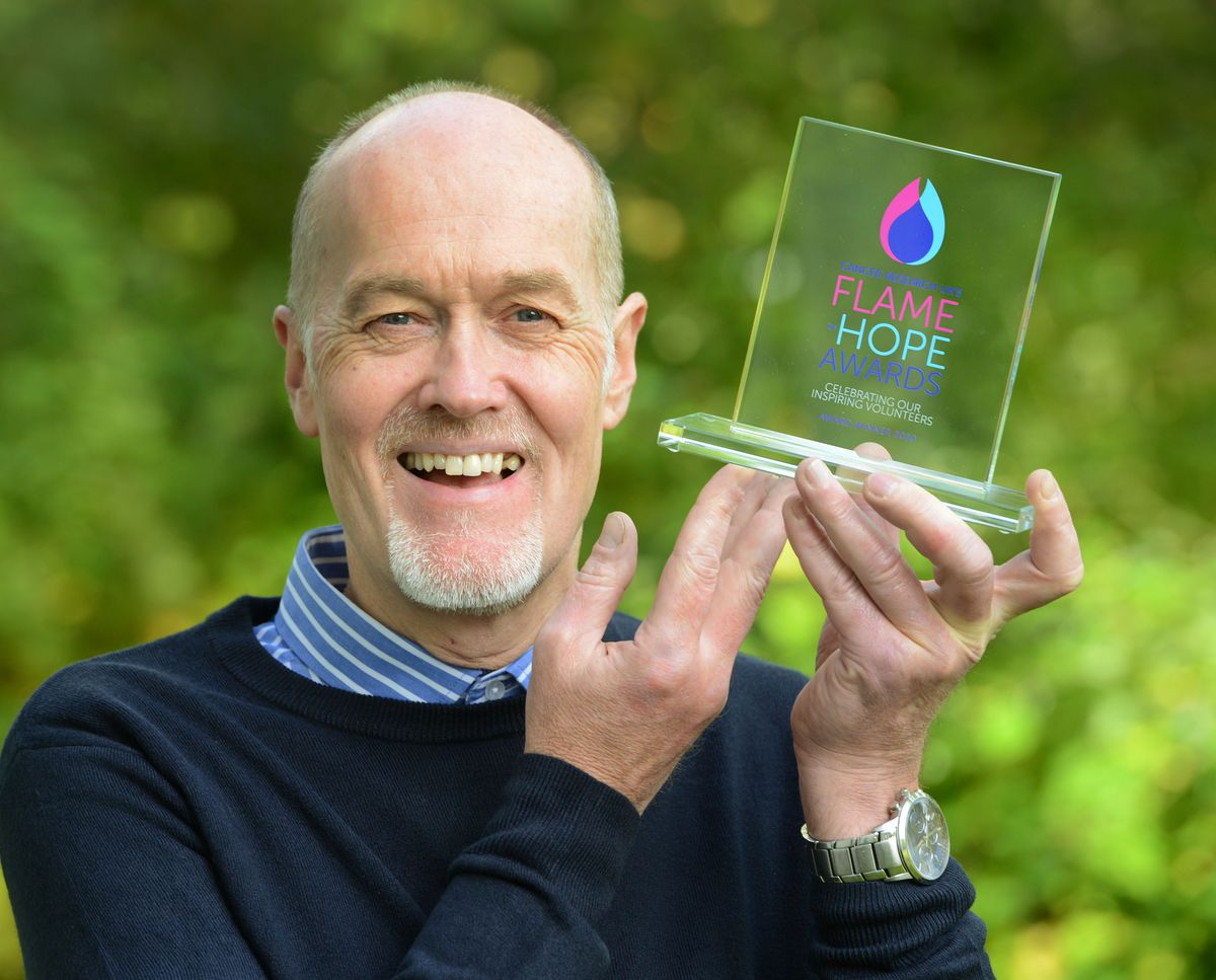 Adrian Webb, from Netherton, with his Flame of Hope award
