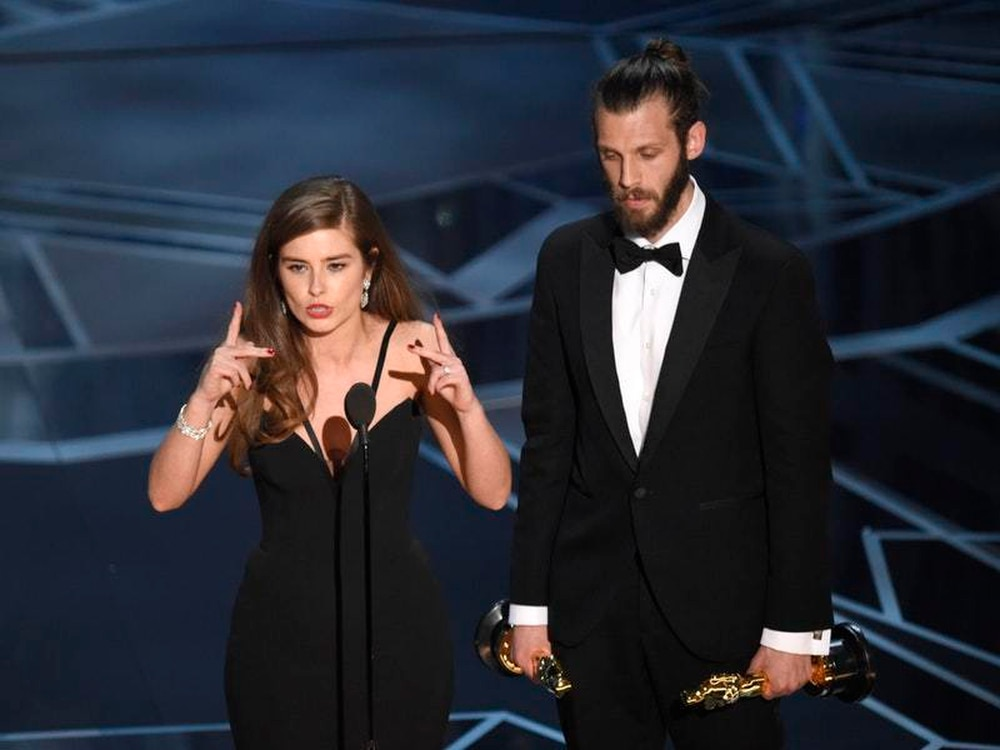Rachel Shenton uses sign language to deliver the acceptance speech