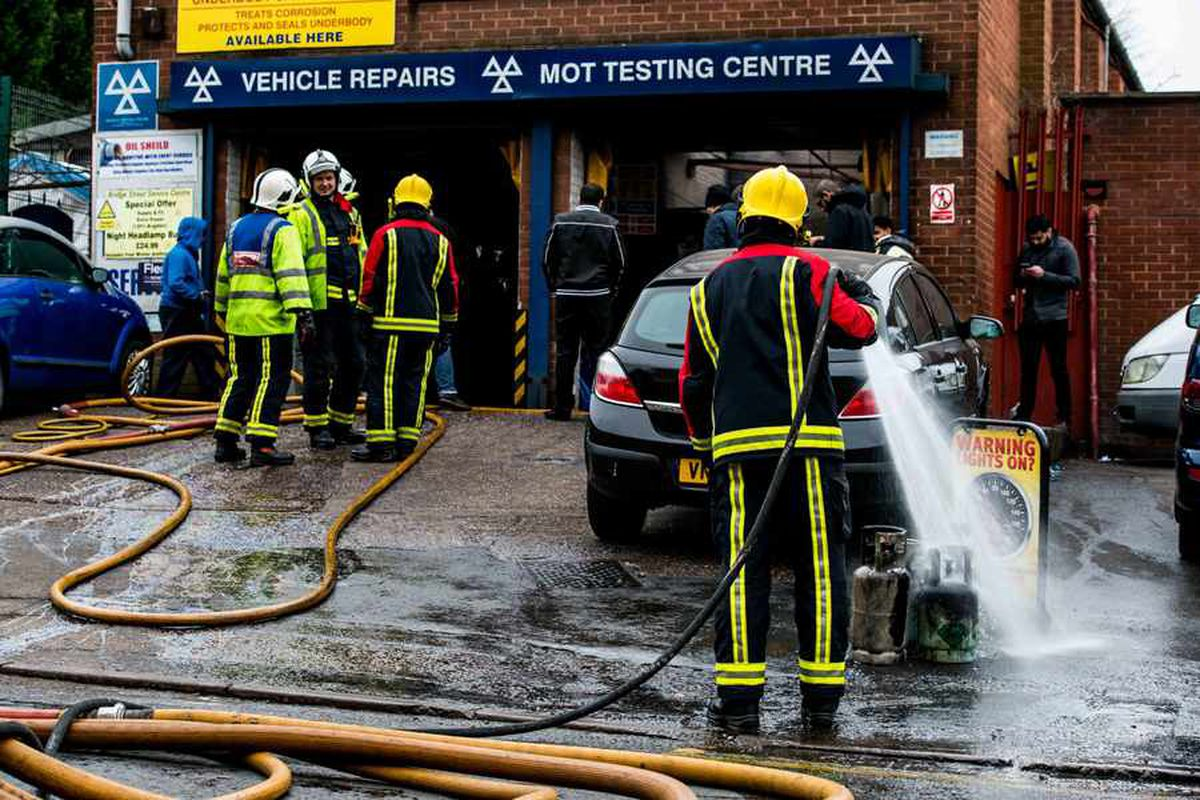 Firefighters tackle severe blaze at Cradley Heath MOT test centre as man taken to hospital with burns