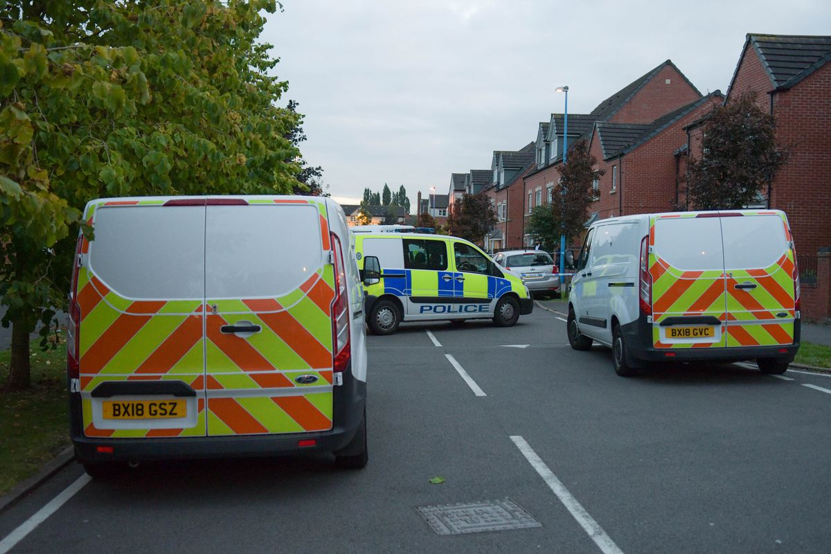 Police at the scene of the shooting in Barrett Street. Photo: SnapperSK