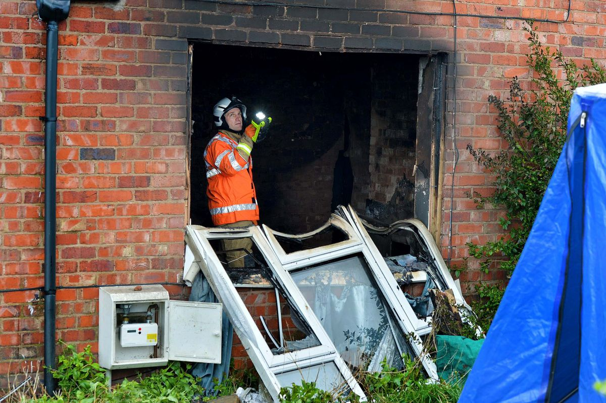Fire investigators at the house on Sunday