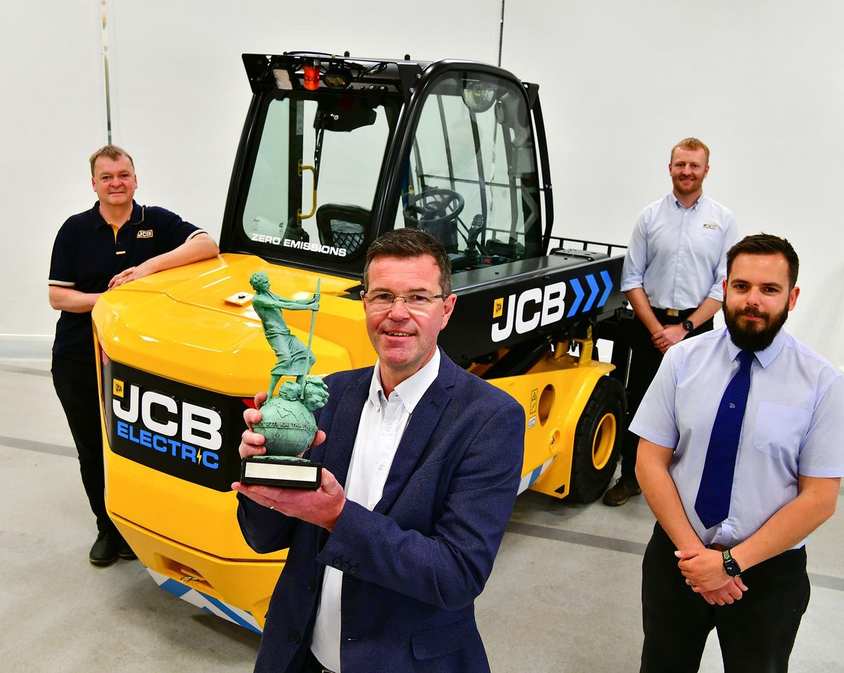 Paul Wild holding the Archie Award for the JCB TLTe. Also pictured from left: Rod Scott, Sam Wilkinson and Lee Harper.
