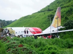 18 dead after plane skids off runway in southern India