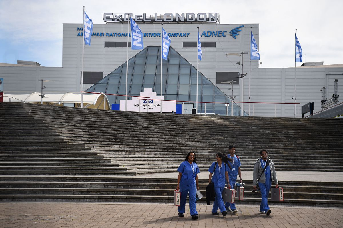 NHS workers leave the NHS Nightingale Hospital at the ExCel centre in London
