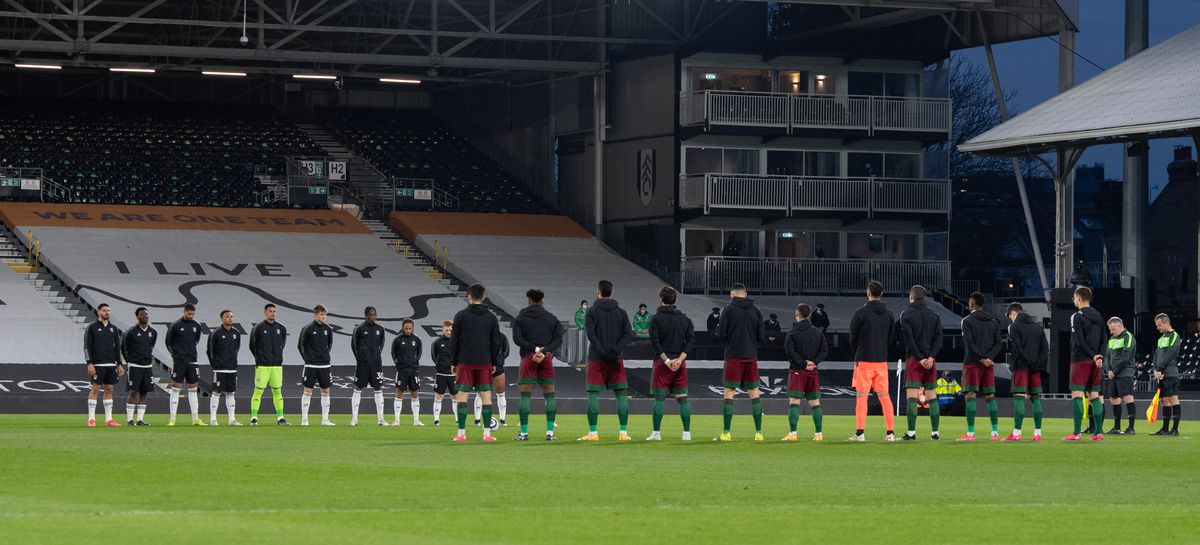 Players of both teams stand for 2 minutes silence in respect of The Duke of Edinburgh Prince Philip (AMA)