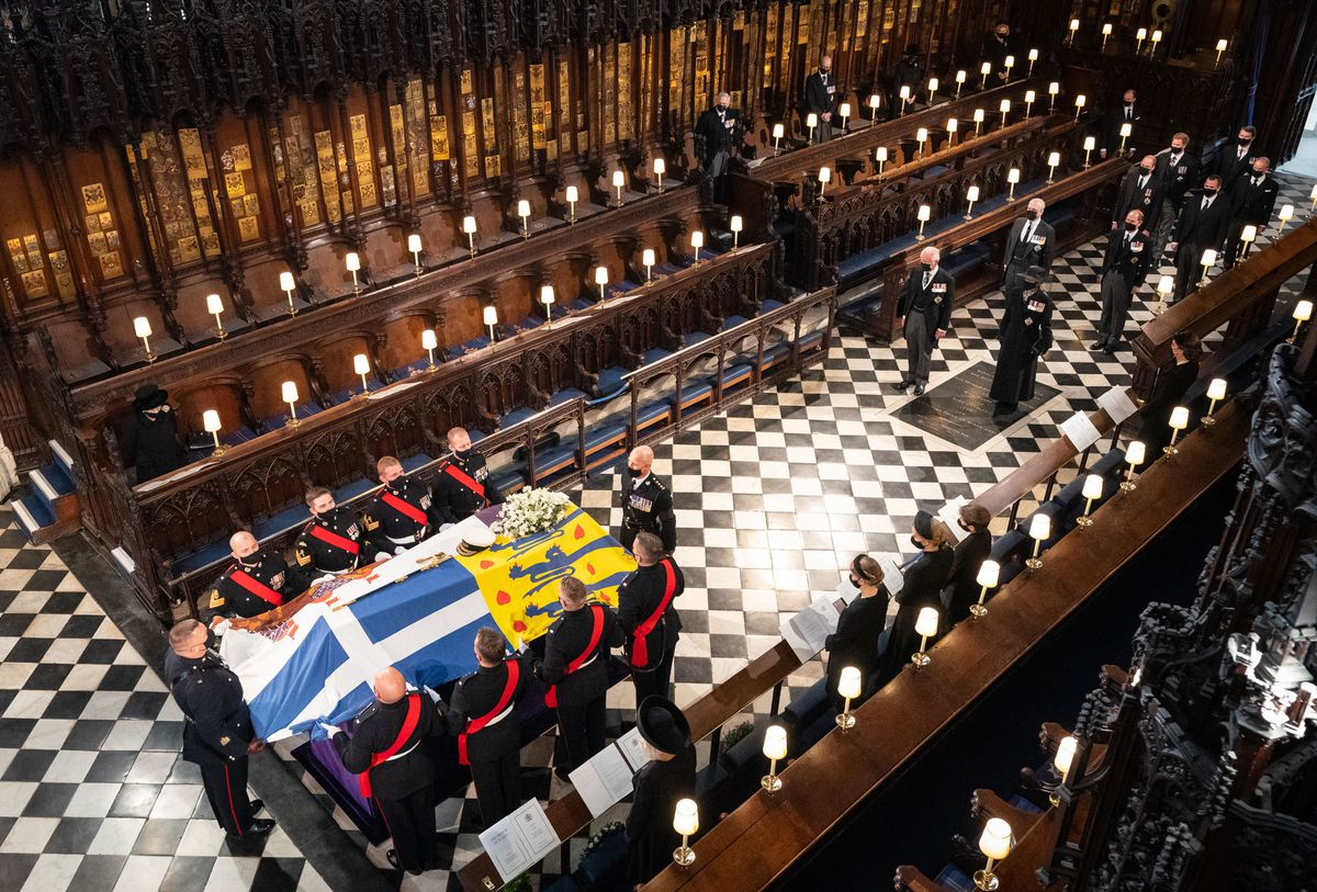 Royal Marine pall bearers carried the coffin into the chapel