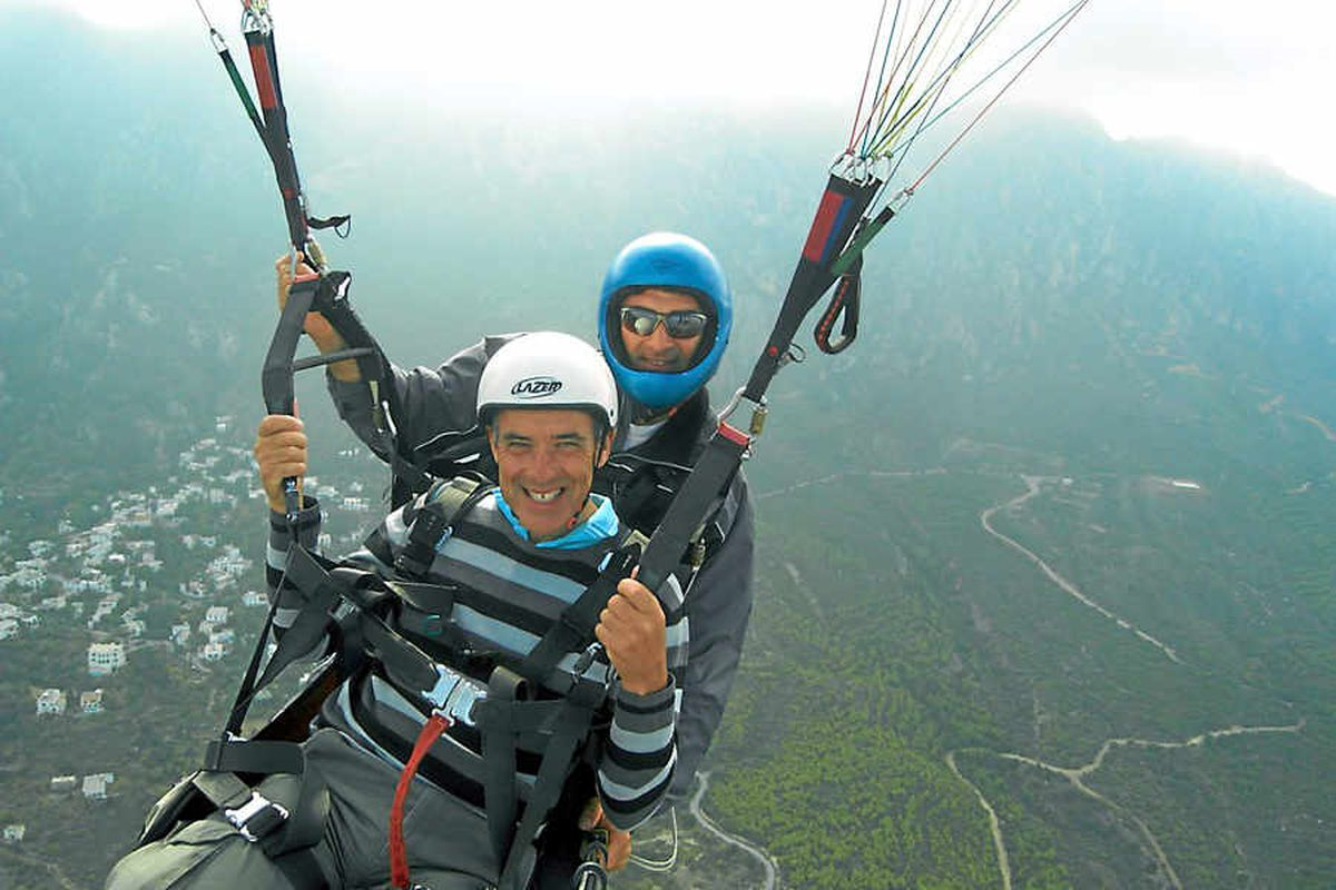 Graham paragliding while celebrating 30 years of marriage