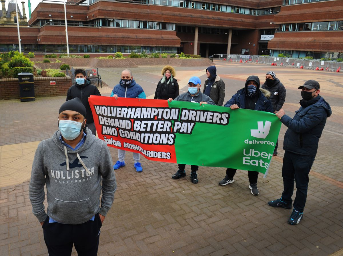 Deliveroo and Uber Eats drivers, including (front) Bachitar Boparal protest as part of a national strike for better worker conditions