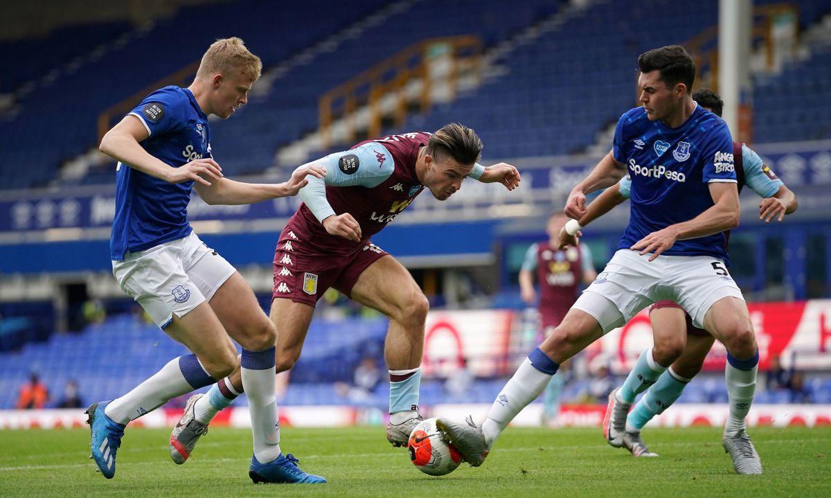 Everton's Jarrad Branthwaite and Michael Keane (right) battle for the ball with Aston Villa's Jack Grealish (centre)