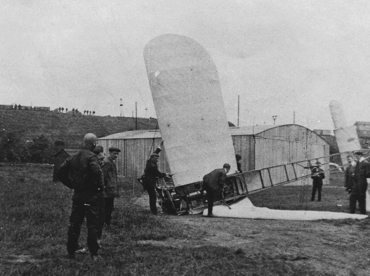 What goes up... Captain George William Patrick Dawes stands in the foreground surveying his wrecked aircraft at Dunstall Park in 1910 after he stalled and crashed. It was successfully repaired.