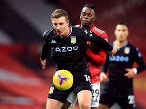 Aston Villa's Matt Targett holds off Manchester United's Aaron Wan-Bissaka