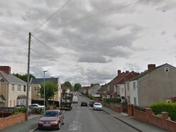 Woman led to safety after cooker fire at home