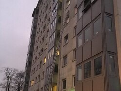 Heroic firefighter rescues boy left hanging by HIS EAR from fifth-floor window