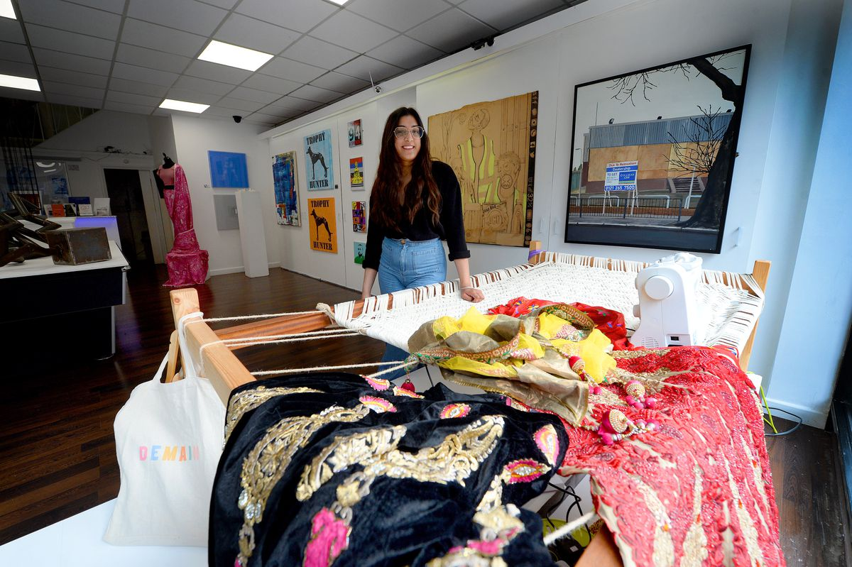 Artist Rupi Dhillon with her window installation