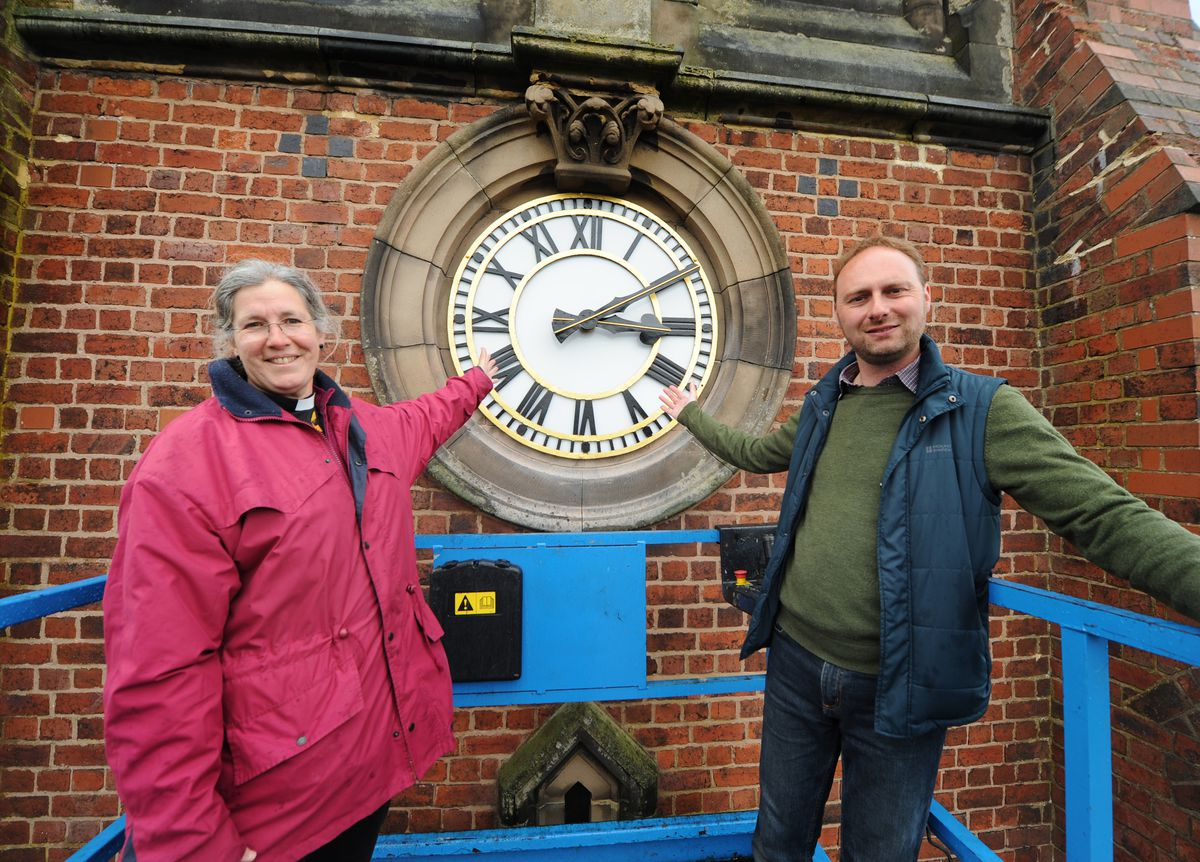 Taking a close look at the clock were Reverend Katryn Leclezio and project co-ordinator James Brookes