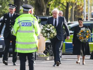 Chief Constable Ben-Julian Harrington, Labour leader Sir Keir Starmer, Prime Minister Boris Johnson and Home Secretary Priti Patel carry flowers as they arrive at the scene near Belfairs Methodist Church in Leigh-on-Sea, Essex, where Conservative MP Sir David Amess died after he was stabbed several times at a constituency surgery on Friday