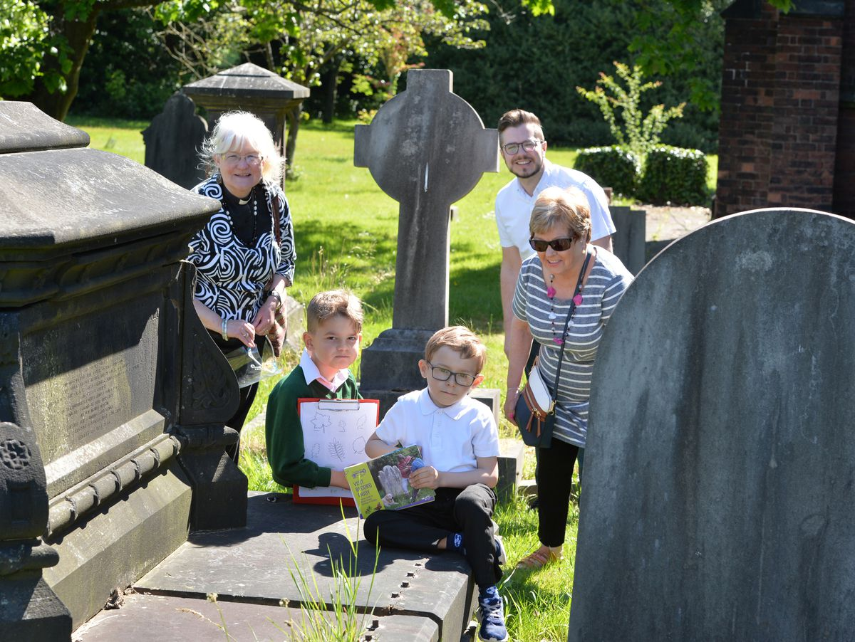 Taking part in a churchyard study, Pelsall Village School pupils (left) Kian Hickman, 7, and (right) Harrison Weston, 7, with reverend Alison Morris, councillor Edward Lee and councillor Rose Martin, at St Michael and All Angels, Pelsall
