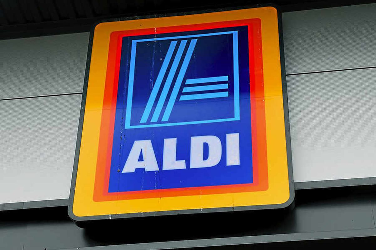 The man was trapped by a car outside Aldi, in Willenhall