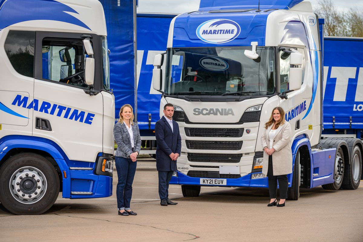 Julie Davies from Midland Expressway with Craig Bickley from Maritime Transport and Sarah Gourlay from Midland Expressway with the first of the Maritime fleet to have number plates registered with M6 Toll