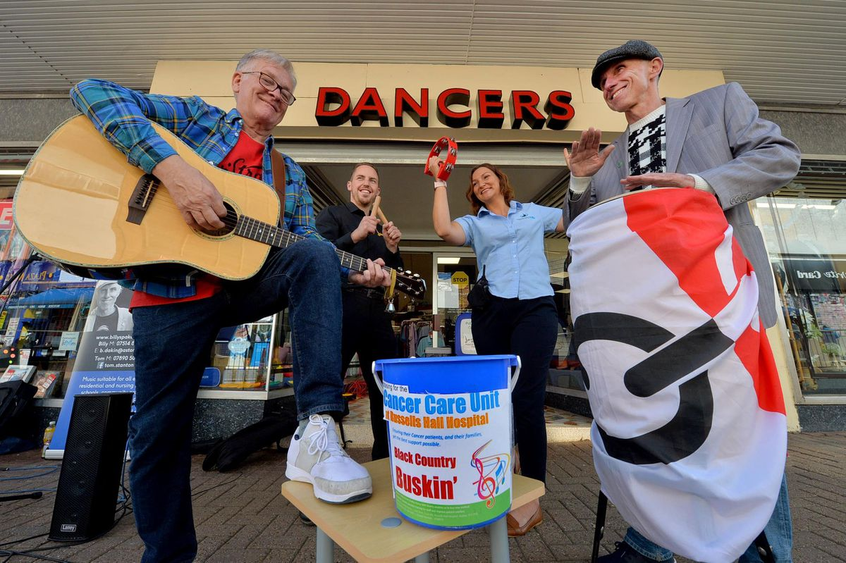 The Blue Granits, Tom Stanton and Billy Spakemon, busk outside Dancers shop in Halesowen to raise money for Russells Hall Hospital Cancer Care Unit. At the back is Dave Dancer from the store and also Vicky Rogers from Halesowen BID..