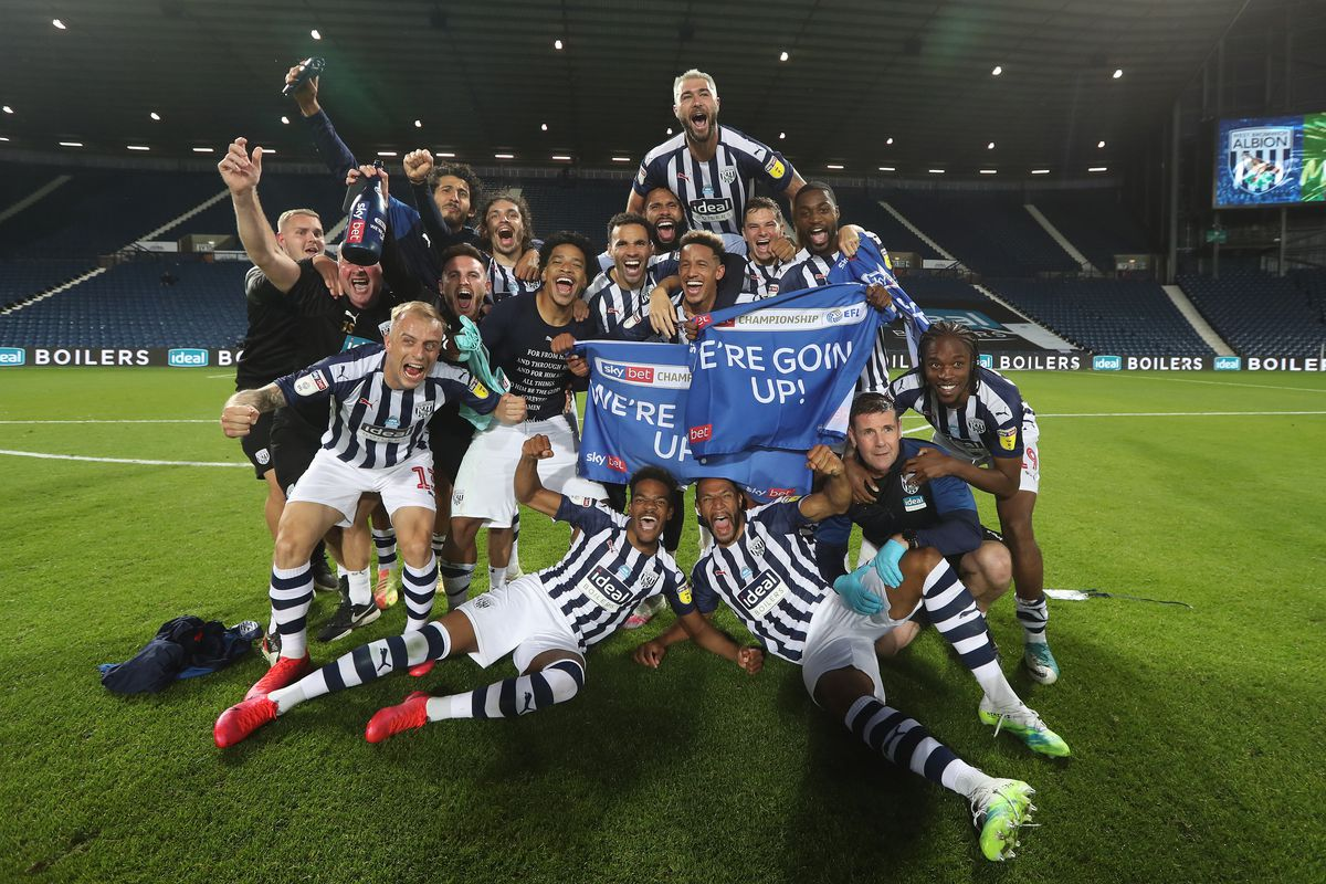 West Bromwich Albion players and staff celebrate promotion to the Premier League on the pitch at the end of the match. (AMA)