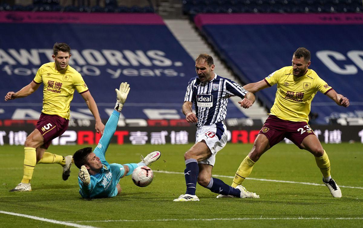 Burnley goalkeeper Nick Pope saves from West Bromwich Albion's Branislav Ivanovic