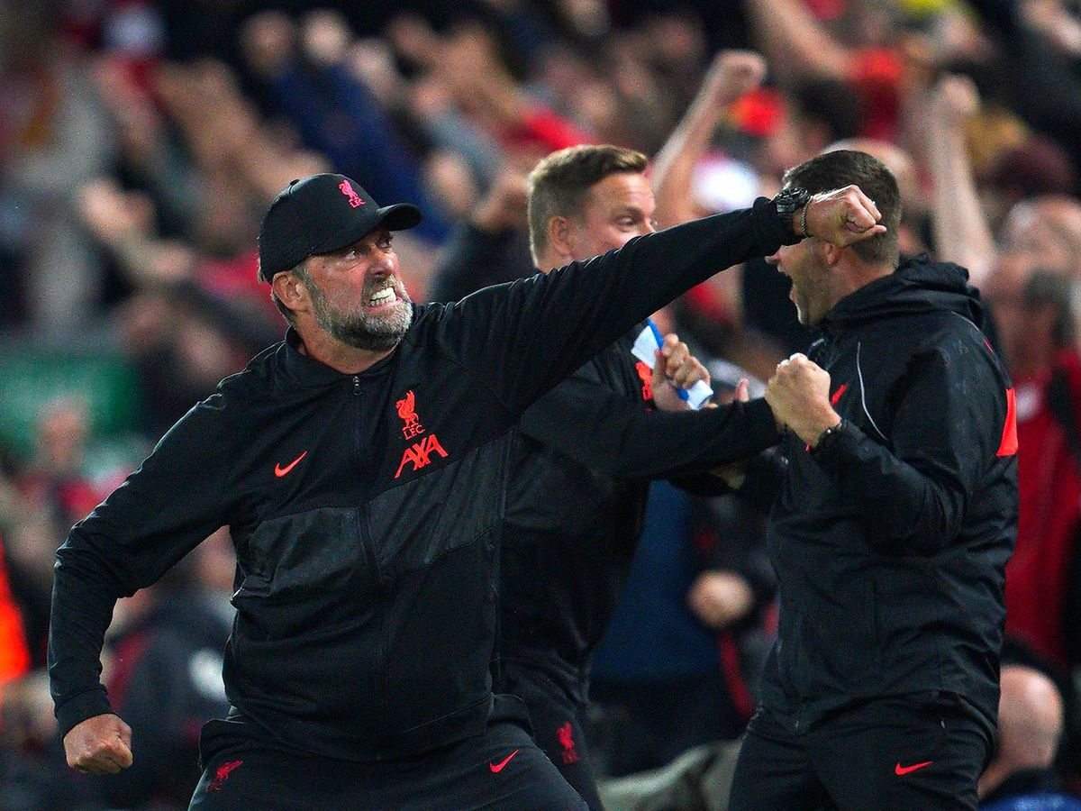 Liverpool manager Jurgen Klopp punches the air celebrating a goal