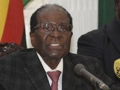 Zimbabwe president defies mounting pressure to leave office