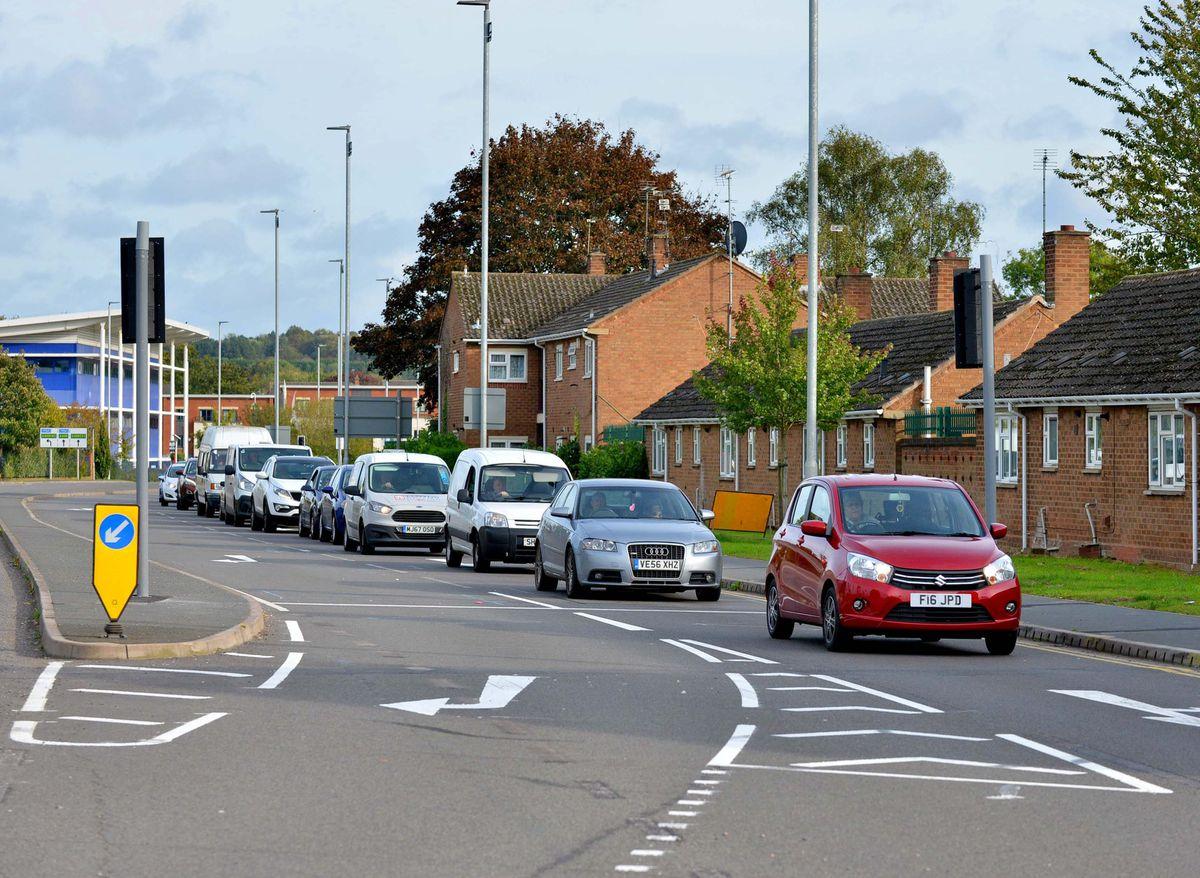 Road widened long-running works scheme cut back