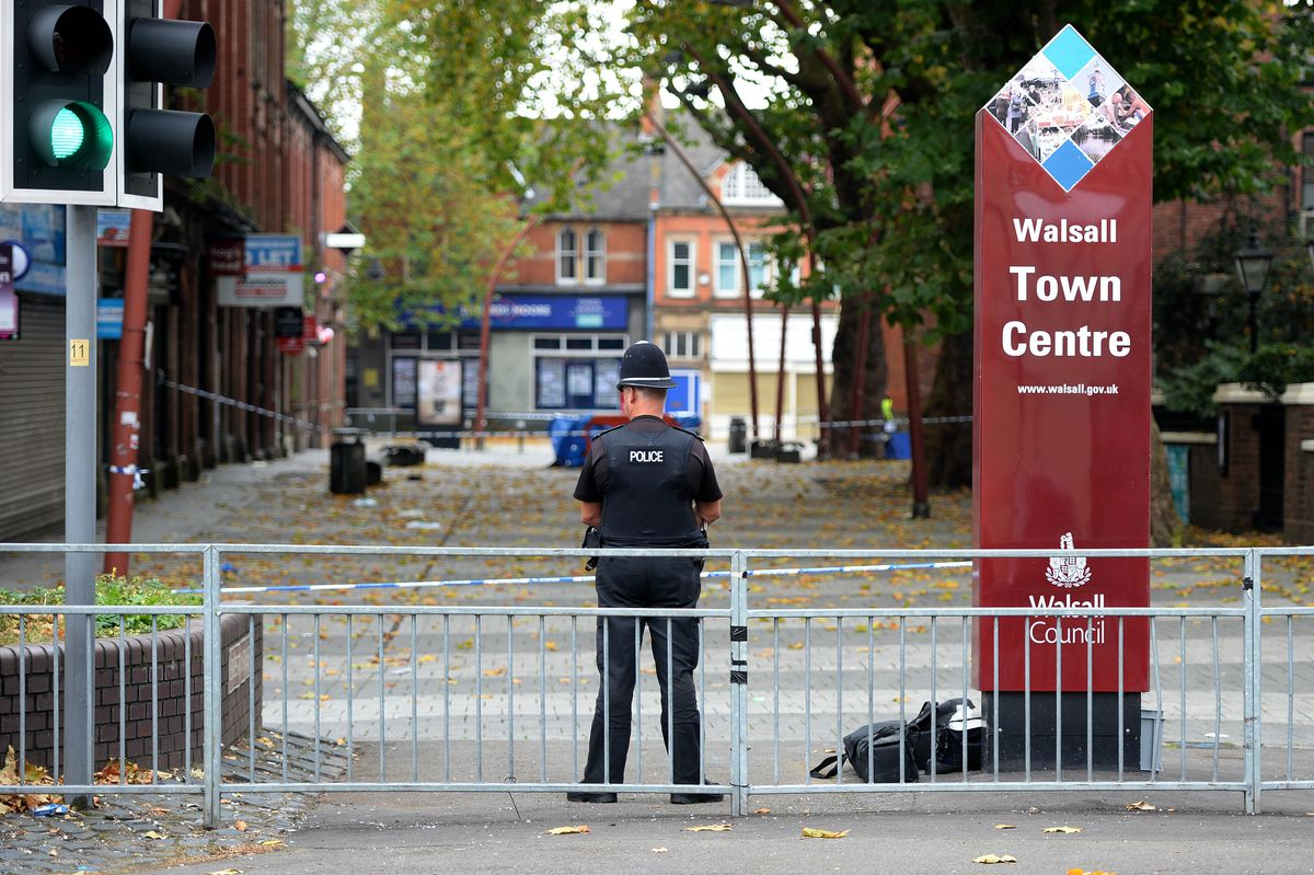 Police cordoned off Leicester Street outside Walsall Town Hall in the aftermath of the fatal attack