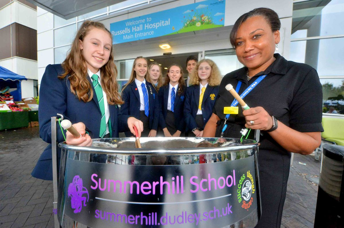 Student Grace and deputy chief nurse Carol Love-Mecrow, with Summerhill pupils Fanni, Hannah, Grace, Ethan and Emelia at Russells Hall Hospital