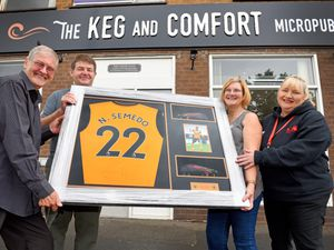 Winner Paul Waddell, left, with John and Louise Clive from the Keg and Comfort, and Jo Bailey from Midlands Air Ambulance