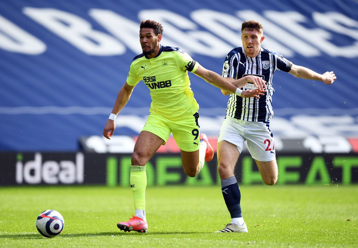 Newcastle United's Joelinton (left) and West Bromwich Albion's Dara O'Shea