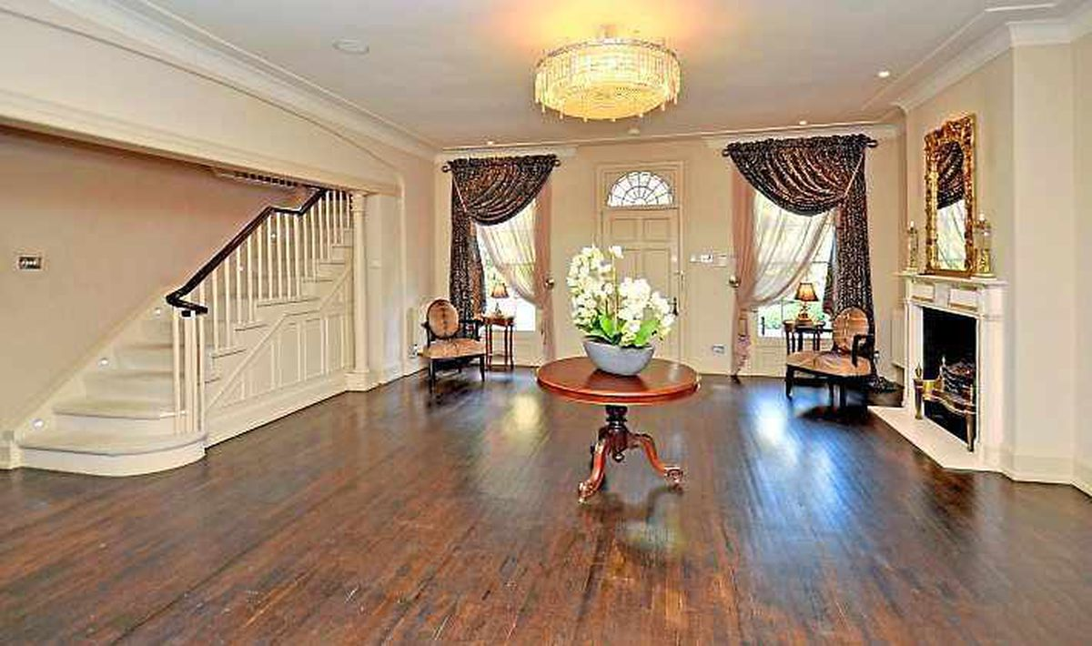 A grand entrance hall greets visitors to the impressive home
