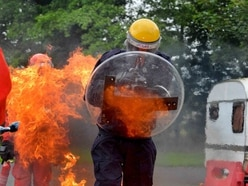 See what it's like to be engulfed by flames from a petrol bomb: We try out police riot training
