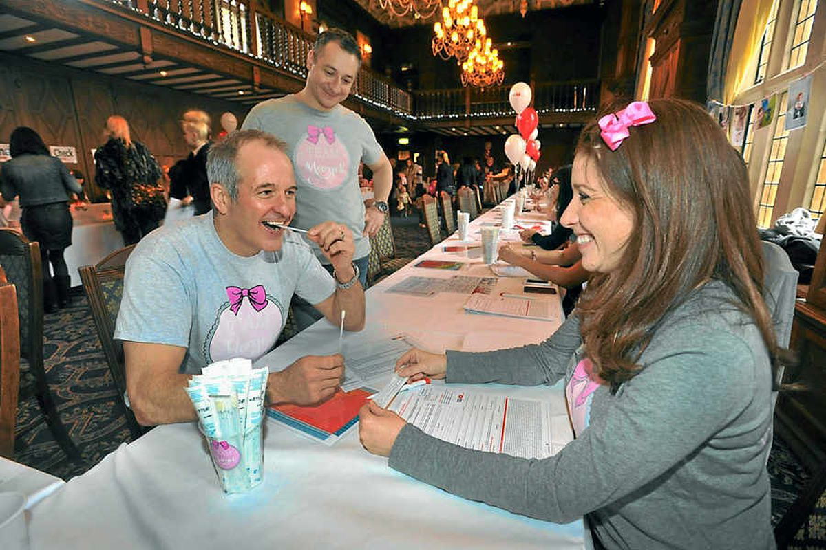 Steve Bull takes part in the donor registration day inspired by Margot Martini, with the little girl's parents Vicki and Yaser.