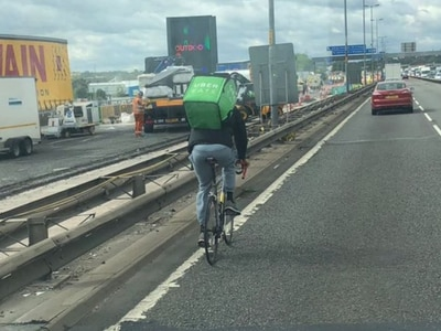 Uber Eats cyclist spotted pedalling takeaway delivery down the M5