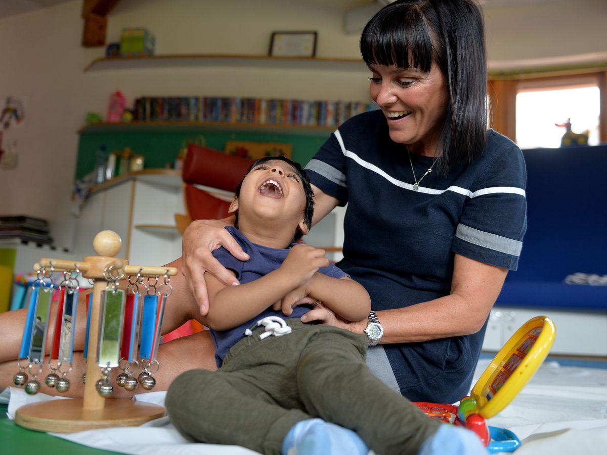 Deputy head nurse Carmel Caldicott with Amad, aged 2