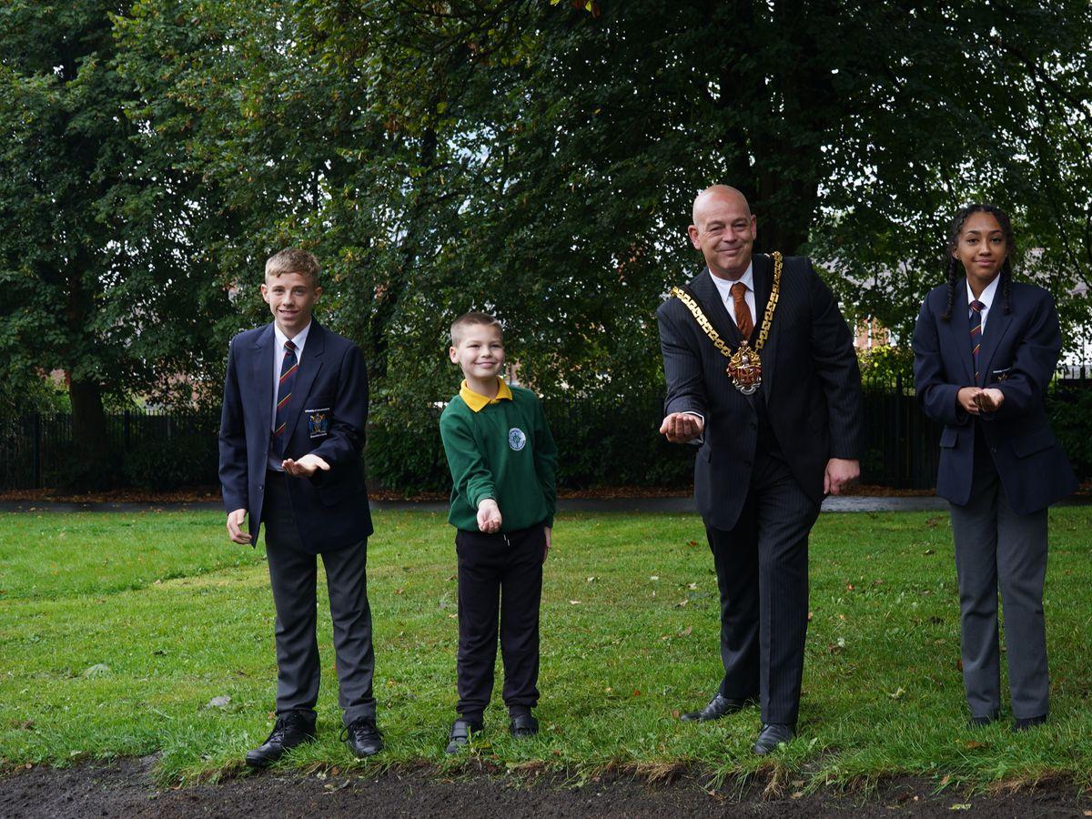 The Mayor of Wolverhampton, Greg Brackenridge, plants seeds with pupils from St Patrick's School and University of Wolverhampton Wednesfield Academy..