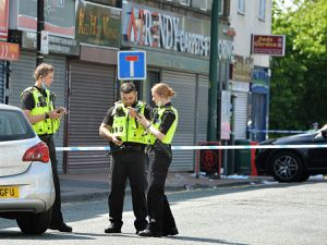 Police at the scene in Wednesbury town centre where Abdi Mohamed was stabbed